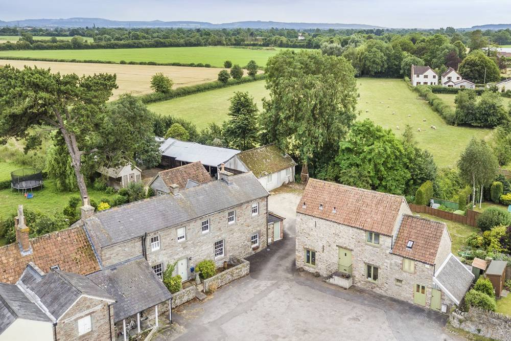 a drone image of a country home